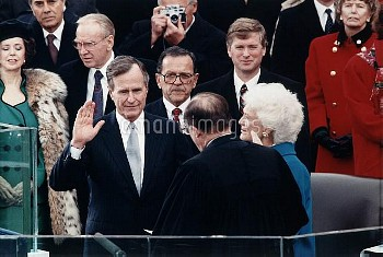President George Herbert Walker Bush takes the oath of office administered by Chief Justice William