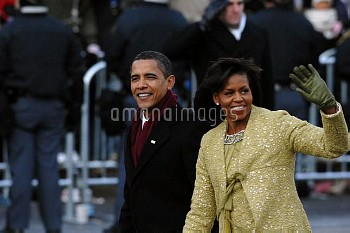 President and Michelle Obama wave to the crowd along Pennsylvania Avenue during the 2009 presidentia