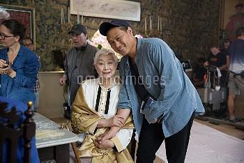 CRAZY RICH ASIANS, from left: Lisa Lu, director Jon M. Chu, on set, 2018. ph: Sanja Bucko /© Warner