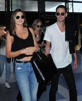 Miranda Kerr Catches A Flight At LAX With Her New Boyfriend Evan Spiegel
