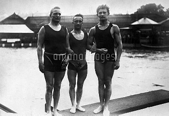 OLYMPIC GAMES, 1912. Three swimmers at the 5th Olympic Games, held in Stockholm, Sweden, 1912.