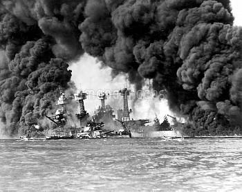 WORLD WAR II: PEARL HARBOR. The USS West Virginia and the USS Tennessee after the Japanese attack on