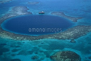 Aerial of Blue Hole, a popular dive site, and coral reef, Belize