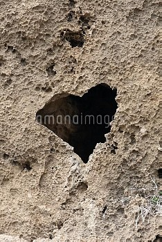 Heart shaped hole in volcanic rock, Cyprus