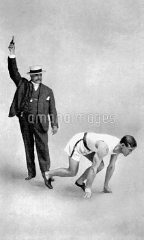 (L-R) Walter H Liginger, Chairman of the US Olympic Committee, fires the starting pistol for Archie