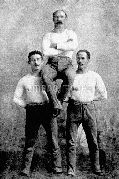Germany's Carl Schuhmann (c), gold medallist in the wrestling and horse vault
