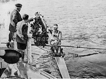 Australia's Henry Pearce is presented with a garland after winning gold