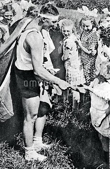 Australia's Henry Pearce, gold medallist in the single sculls, meets a young fan