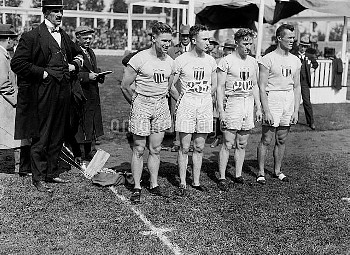 The winning United States team, left to right Charlie Paddock, Jackson Sholz, Loren Murchison and Mo