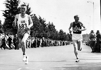 Czech athlete Emil Zatopek (R) on his way to winning the Marathon event, at the 1952 Olympic Games,