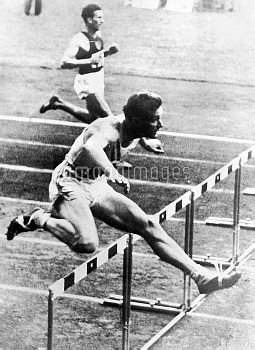 USA's Charles Moore clears a hurdle on his way to winning gold