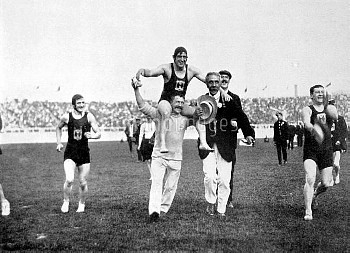 Great Britain's Henry Taylor is carried shoulder-high around the White City stadium after swimming t