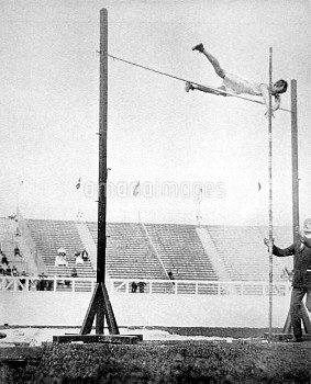 USA's Alfred Gilbert clears the bar at 3.71m to tie for the gold medal