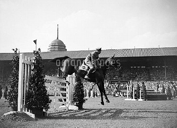 One of the competitors jumping a fence during the Prix Des Nations.