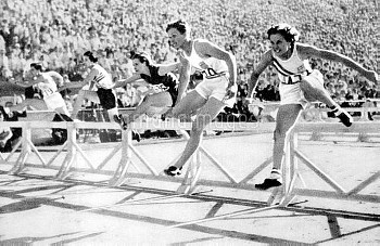 USA's gold medallist Mildred 'Babe' Didrikson (second r) leads off the last hurdle, followed by team