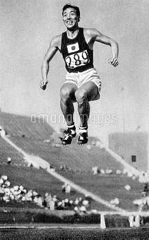 Gold medal winner Chuhei Nambu of Japan set a new world record when he jumped 15.72 m