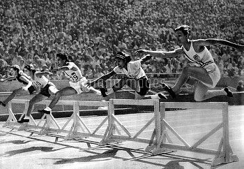 Eventual gold medallist Mildred 'Babe' Didrikson, USA, (r) clears the first hurdle in her heat