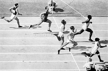 USA's Eddie Tolan (bottom r) wins gold from teammate Ralph Metcalfe (second r) and Germany's Arthur