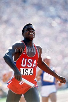 USA's Carl Lewis celebrates after anchoring his team to gold, his fourth of the Games