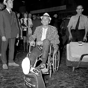 British boxer Terry Waller sits in a wheelchair injured before being rolled to the airport bus at He