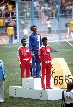 (L-R) The medallists stand to attention during the winner's national anthem: USA's Fred Newhouse (si