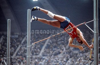 USA's Bruce Jenner clears the bar during the pole vault discipline of the decathlon