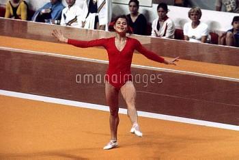 USSR's Olga Korbut performs her floor routine wearing a broad smile
