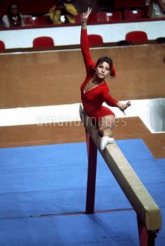 USSR's Olga Korbut performs the splits on the beam
