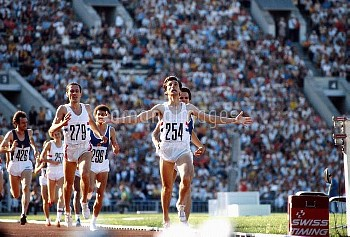 Great Britain's Seb Coe (r) celebrates winning gold as he crosses the line ahead of East Germany's J