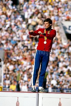 Great Britain's Seb Coe celebrates on the podium after receiving his gold medal