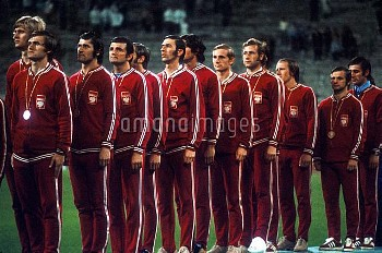 The Poland team line up with their gold medals to listen to the national Anthem after beating Hungar