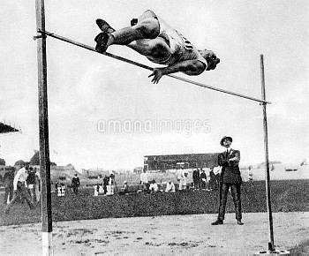 USA's Harold Osborn clears the bar to win gold with a leap of 1.98m