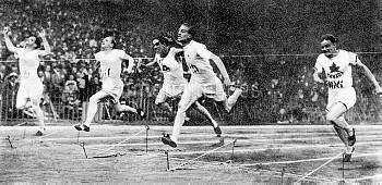 Great Britain's Harold Abrahams (second right) wins his semi final from USA's Charles Paddock (secon