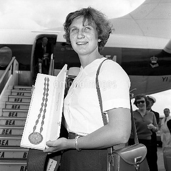 Anita Lonsbrough, with her Olympic gold medal for the 200 metres breast stroke
