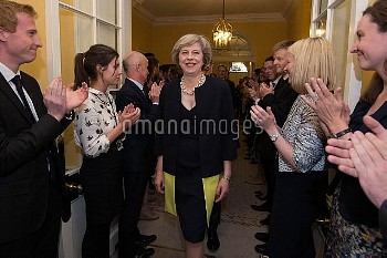 Staff clap as new Prime Minister Theresa May walks into 10 Downing Street, London, after meeting Que