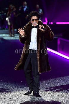 Bruno Mars performs on stage during the Victoria's Secret fashion show, held at The Grand Palais in