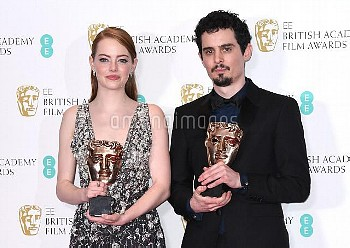 Emma Stone with the award for Best Actress and Damien Chazelle with the awards for Best Director 'La