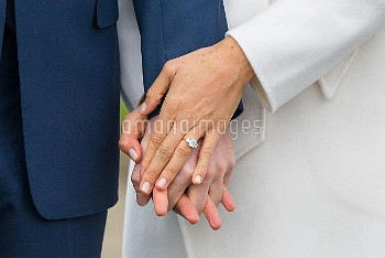 Prince Harry and Meghan Markle in the Sunken Garden at Kensington Palace, London, after the announce