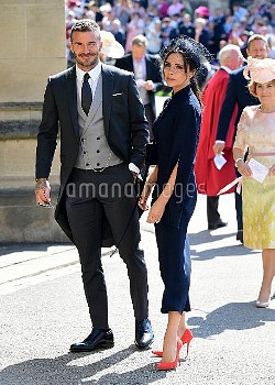 David and Victoria Beckham arrive at St George's Chapel at Windsor Castle for the wedding of Meghan