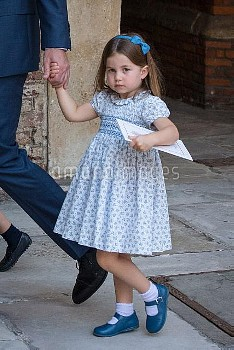 Princess Charlotte holding the hand of the Duke of Cambridge after attending Prince Louis's christen