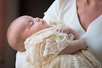 The Duchess of Cambridge carries Prince Louis as they arrive for his christening service at the Chap