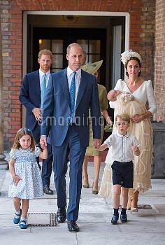 Princess Charlotte and Prince George hold the hands of their father, the Duke of Cambridge, as they