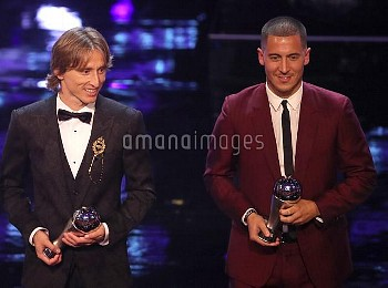 Luka Modric (left) and Eden Hazard poses with their FIFA FIFPro World 11 awards during the Best FIFA