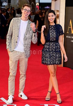 Callum Leighton Airey and Emily Canham are handcuffed together whilst attending the UK Premiere of A