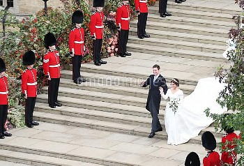 Princess Eugenie and her new husband Jack Brooksbank walk down the West Steps as they leave St Georg