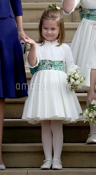 Princess Charlotte waves to Princess Eugenie and her new husband Jack Brooksbank as they leave St Ge