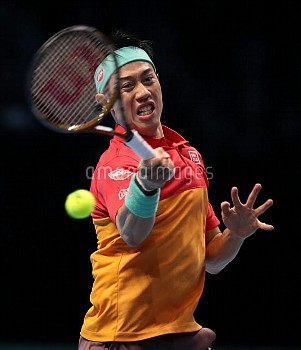 Kei Nishikori during the men's singles group stage match against Roger Federer during day one of the
