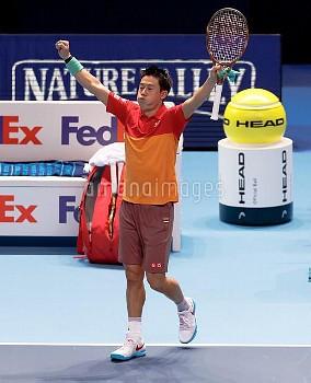 Kei Nishikori celebrates winning the men's singles group stage match against Roger Federer during da