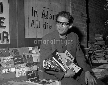 June 2, 1959 - San Francisco, California, United States: Allen Ginsberg is holding a copy of Dr. Sax