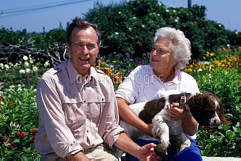 George Bush with wife Barbara and Millie, their Springer spaniel.